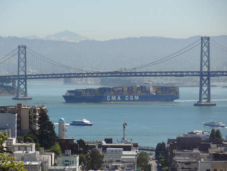 San Francisco Bay Bridge and cargo ship photo