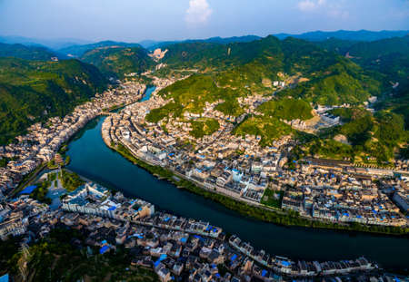 AERIAL shot of Traditional houses and bridge on Wuyang River,Guizhou,China.
