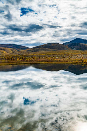Panorama of wild forest lake in autumn, Russia