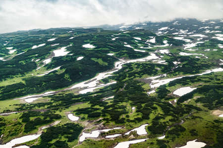 Aerial view of landscape with green plains on Kamchatka Peninsula, Russia