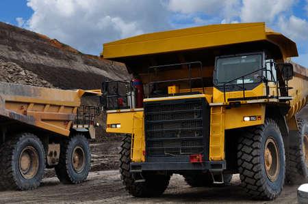 big truck hauling moving material over burden
