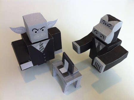 Origami pig and gorilla doing business.