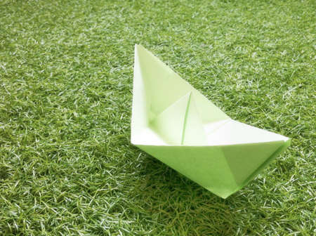 A paper boat on the grass