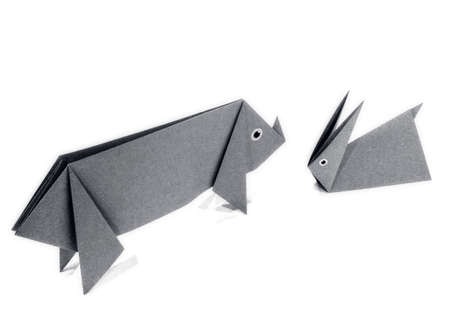 Origami pig and rabbit in the white background. Stock Photo