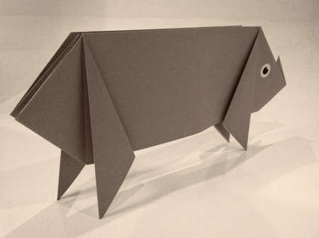 Origami pig in the white background. Stock Photo
