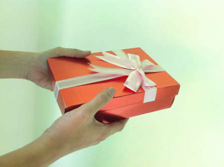 Giving gift box. Stock Photo