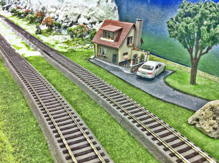 Toy house and train track background. Stock Photo