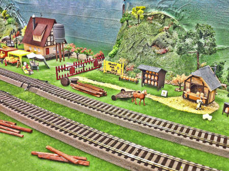 Toy farm and train track background. Stock Photo