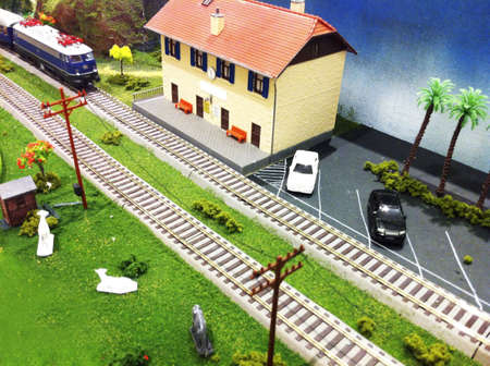Toy train and house background.