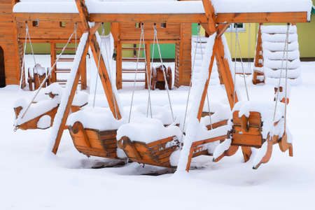 Children's playground covered with snow. Stockfoto