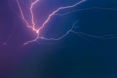 Thunderclouds with lightning in the night sky. Stockfoto