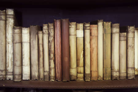 Ancient medieval books on the shelf in the bookcase. Medieval library. Foto de archivo - 131694162