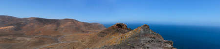 Panorama of the Spanish island of Fuerteventura, stones, rocks and the ocean.