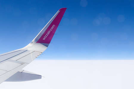 Fuerteventura, Spain - May 23, 2019: Wizzair airline wing. Sky view from the airplane window.