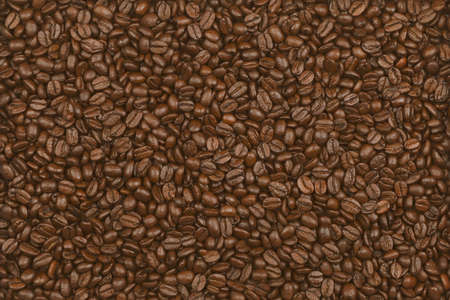 Scattering of coffee beans, close up.