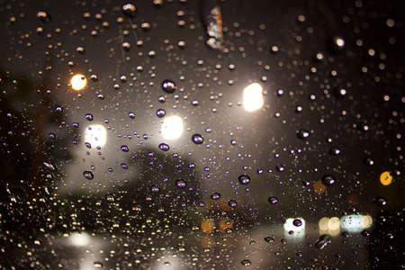 refelction: Night rain drops illuminated Stock Photo
