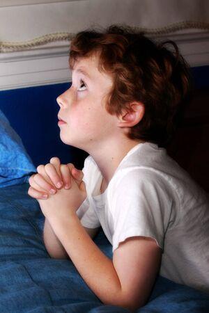 young boy praying Stock Photo