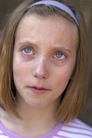 distraught: pretty young blue-eyed girl with tears Stock Photo