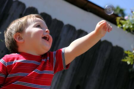 adorable baby reaching for a bubble Stock Photo - 7352130