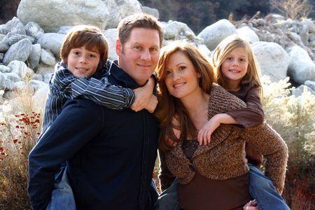 beautiful happy family piggyback
