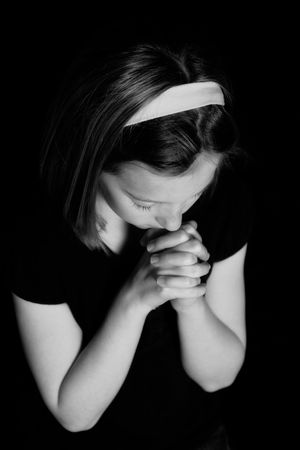 young girl praying in black and white Archivio Fotografico