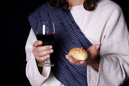 Jesus Christ holding out the wine and bread of communion photo
