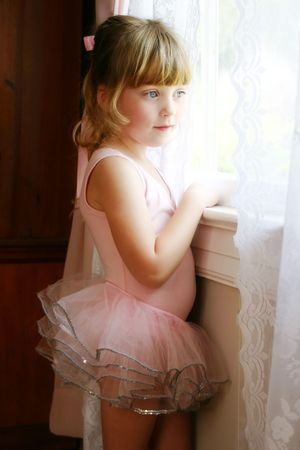 leotard: ballerina child gazing out of window dreaming