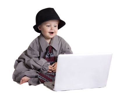 happy baby playing on a computer Stock Photo