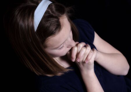young girl praying photo