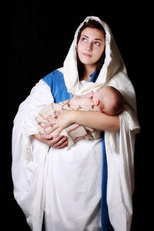Mary holding baby Jesus and gazing toward Heaven
