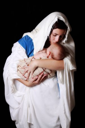 mary and jesus: Mary kissing the baby Jesus Stock Photo