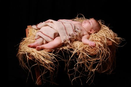 Baby Jesus in slaap in the manger Stockfoto
