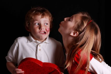 little boy disgusted by incoming valentine kiss photo