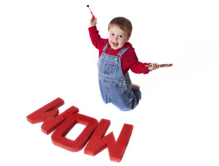 little toddler painting a sign photo