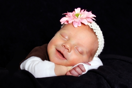 beautiful sleeping baby with a smile