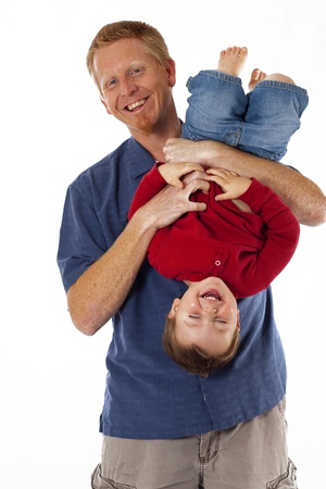 Happy father holding and tickling his laughing toddler child