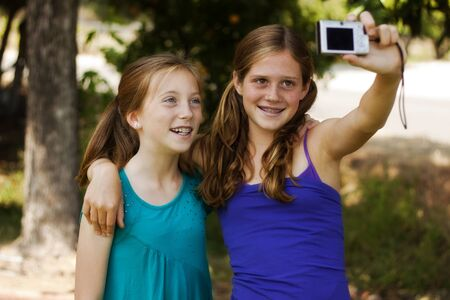 happy young girls posing for a picture photo