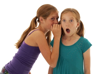 ponytails: Pretty young girls telling shocking secrets Stock Photo