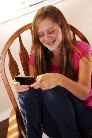 pretty teen girl texting photo