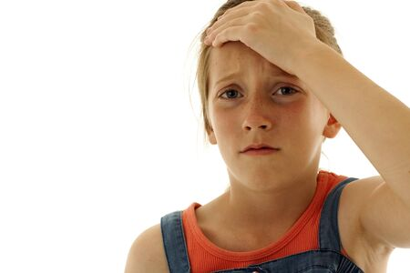 young girl holding her head in disappointment or pain