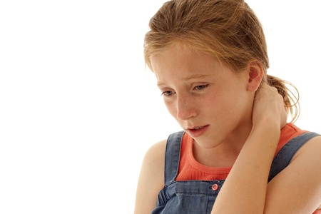 freckle: young girl holding her neck in pain or sorrow Stock Photo