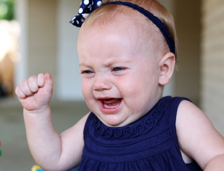baby girl throwing a crying tantrum Archivio Fotografico
