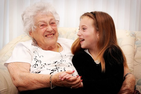 grandmother and children: senior woman and grandchild laughing and visiting