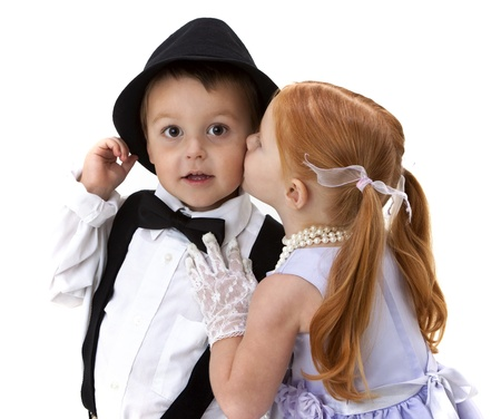 adorable little boy and girl kissing photo