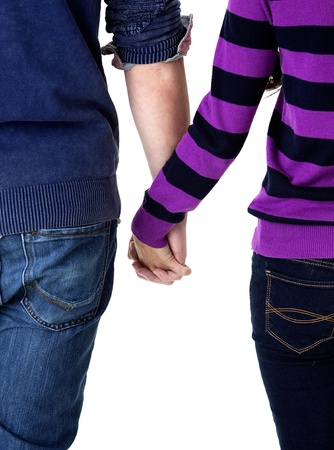 teen couple holding hands rearview Stock Photo