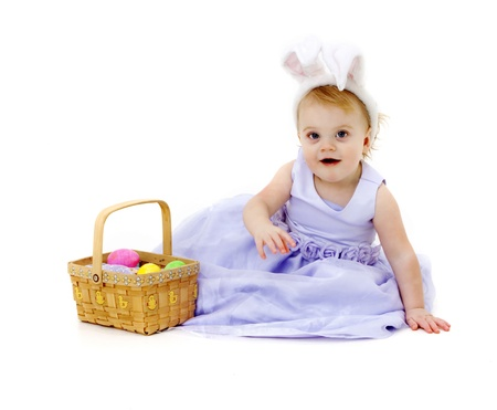 bunny ears: baby girl with bunny ears and Easter basket Stock Photo
