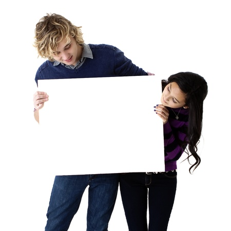 young couple holding blank sign Archivio Fotografico