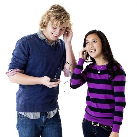 teen couple listening to music on shared headphones