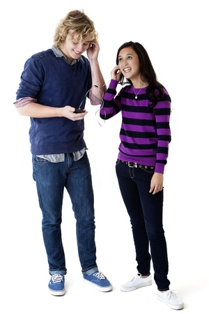 happy young couple listening to music on a smart phone Stock Photo