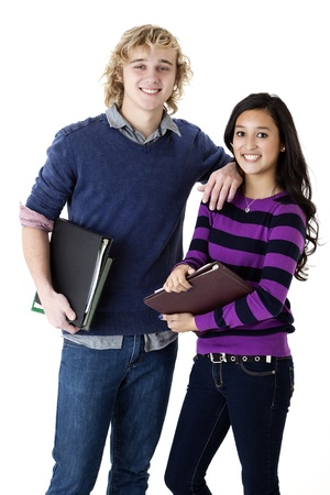 school friends: successful teen students holding their books